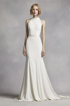 This minimalist chic crepe gown will have you looking classicly flawless as  you say your I Do   Halter bodice features a chic 7ad0738a6