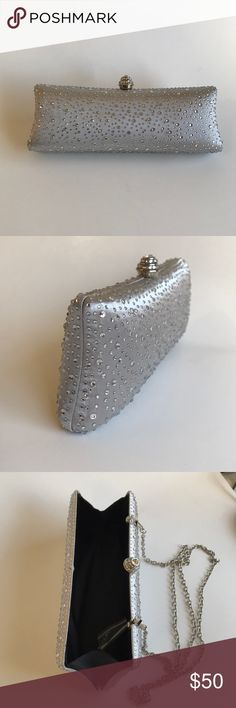 🎉Beautiful new sparkly clutch🎉 Sparkly clutch with diamanté clasp. Color is silver with clear crystals. iPhone 6/7 can fit in with room for other essentials. Fully lined with detachable chain strap and additional crystals. Approximate measurement: 9.5in x 3.5 in x 1.5 in. Detachable strap has a hang length of 24in and is a standard length for crossbody. Available in gold, Rosegold, Black with silver stripes and silver with black stripes. Please see other listings. Www.kiarapurse.com Kiara…