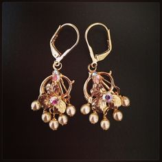 Repurposed 1920's clasp earrings. $25 D. Wallace Designs