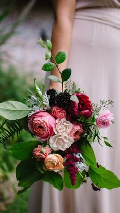 Like the shape the greenery around the bouquet gives it