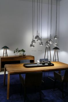 Another beautiful shot of the booth of Ligne Roset at IMM Cologne. The pendant lamp was one of our favorites!