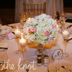 The centerpieces were an arrangement of peonies, David Austin roses, hydrangeas and garden roses that sat on antique crystal cake plates to give the reception room a romantic feeling.