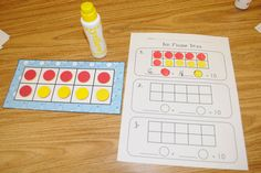 Mrs. Ricca's Kindergarten: Ten Frame Toss. Spill out ten double sided (r) counters.  Fill in 10frame with dot paint.  Write equation.