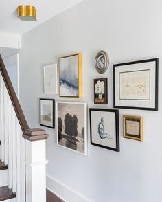 An eclectic gallery wall is the perfect solution for a narrow hallway.  We'll be sharing a new VIDEO tomorrow on how to get the look!