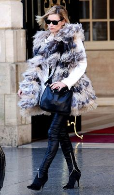 Kate Moss looking ever chic in fur and Balmain boots