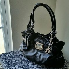 SIENNA RICCHI.....BEAUTIFUL BLACK ....PURSE.... ...EXCELLENT CONDITION  ...LIKE NEW  ...ONE FLAW. ...BEAUTIFUL  ...A MUST HAVE ...true to its size and color ...PLEASE READ ... HAS ONLY ONE FLAW. ...IN 2 PIC..HAS ONE TINY SCRATCH LOGO FRONT ...THAT'S IT.... ...2 pic up close  ...4 PIC YOU CAN SEE ..HAS NO FLAWS. ...3 divider inside. ...middle one has zipper ...zipper pocket ...pockets on each side...outside ...logo..Deco on outside  ...logo...key chain ...measurement. ...adding soon…