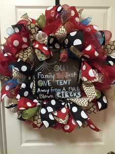 Clown tent deco mesh wreath with reds and blacks. Polka dots   https://www.facebook.com/ggsdecos/