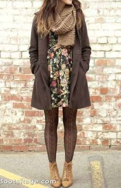 she is wearing a wolly scarf and a wolly jacket. She's wearing a flowery dress and leather boots.