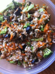 Buddah Bowl.   Brown rice, carrots, broccoli, olives, sunflower seed, chick peas, ground flax, Braggs liquid amino's. add whole wheat pocket pita bread and a smear of hummas to make it utensil free.  All organic ingredients...!