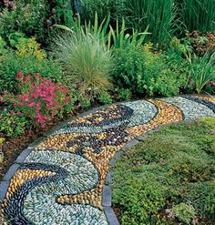 pebble mosaic sidewalk provides a flowerbed border from the My Home Ideas website