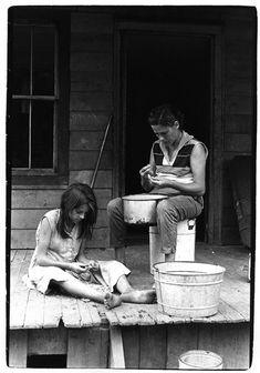 William Gedney: Vivian Cornett and daughter on porch shelling beans
