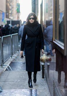 Carine Roitfeld wearing a black coat outside Calvin Klein on February 10 2017 in New York City