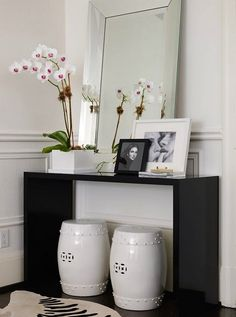 Love a small modern table for a foyer. This can so easily be done with Ikea's occasional table http://www.ikea.com/us/en/catalog/products/80196480/