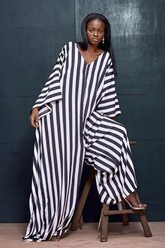 We reinvented the oversized jumpsuit. This is the classic Agbada jumpsuit in crepe with a kimono silhouette. This is the perfect holiday ready summer loving jumpsuit Ghanaian Fashion, African Fashion, Kimono Dress, Kimono Top, Agbada Styles, Kente Styles, White Chic, African Women, Unique Fashion