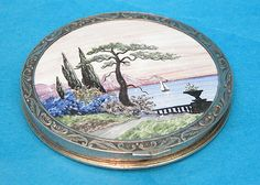 Sterling compact with Oriental scene enameled lid,