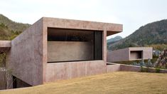 A pink pigmented concrete building designed by David Chipperfield's studio for a cemetery in the Inagawa has been captured in photographs byEdmund Sumner