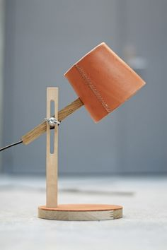 This petite leather lamp is perfect for a side table or small desk.