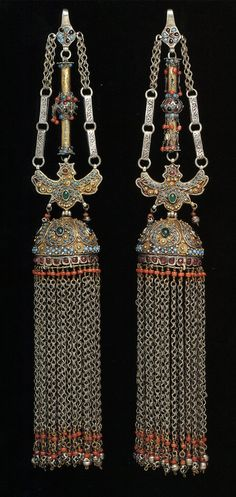 Uzbekistan | Pair of temple pendants; partly fire-gilded silver, turquoise, coral and other materials. H: 36 cm | ©The Splendour of Ethnic Jewelry: From the Colette and Jean-Pierre Ghysels Collection. Text: France Borel. Photographs: John Bigelow Taylor. Thames and Hudson, 1994. Page 128