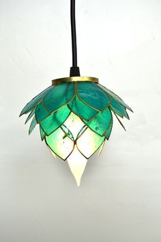 Lotus Blossom Pendant lights  - 100% natural and recycled. I wish this were bigger but it's so pretty and comes in several colors