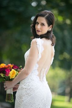 Stunning fitted lace wedding dress by Lihi Hod with a deep, low cut illusion back {Kelly Brown Weddings}