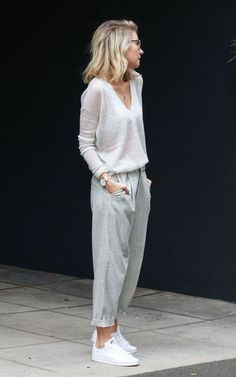 Lovely wispy light grays. Long sleeved v-neck translucent cashmere sweater in a color somewhere between white and gray paired with gray trouser style ankle grazer pants rolled to a cropped length. White sneakers. Watch, necklace, sunnies. Delicate, casual, elegant. Style Planet
