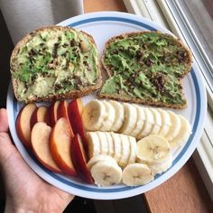 sweeterthanabumblebee: avocado toast topped w nuts and seeds, and a side of nectarine and banana slice