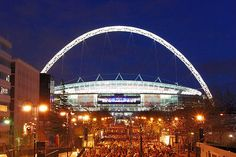 Wembley Stadium at night.