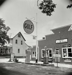 """July 1942. """"Gasoline rationing -- service station in Mechanicsville, Maryland."""" Photo by Marjory Collins for the Office of War Information."""