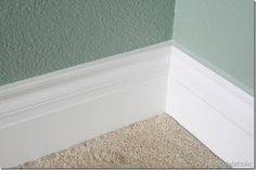 how to get perfect corners and edges on molding -- the trick is caulk and this tells you all of the best ways to do it! Floor Molding, Moldings And Trim, Base Moulding, Crown Molding, Orange Peel Textured Walls, Caulk Baseboards, Unsecured Loans, Wainscoting, Bathroom Baseboard