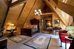 Country Master Bedroom with High ceiling, Exposed beam, Carpet, Chandelier
