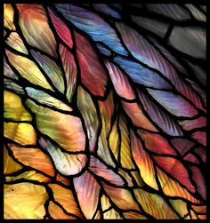 On Chicago's Navy Pier, there is a nice (and free) stained glass museum with lots to see and try and photograph! This is a small detail of a large window. The pieces in this shot are feathers in an angel's wing.