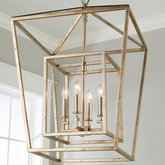 A perfect mix of contemporary design with modern shapes, this lantern's geometric flair in a distressed Silver or Gold finish is an attractive choice above a kitchen island, foyer or living room. Chandelier Design, Entry Chandelier, Entry Lighting, Lantern Chandelier, Chandelier Lighting, Kitchen Lighting, Lighting Ideas, Circular Chandelier, Lantern Light Fixture