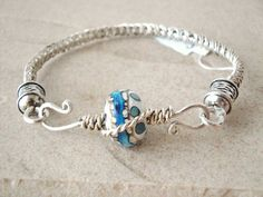 Fish tail braided wire bracelet. sterling silver with  fancy clasp. blue. Spring trend. Pastel colors on Etsy, $52.00