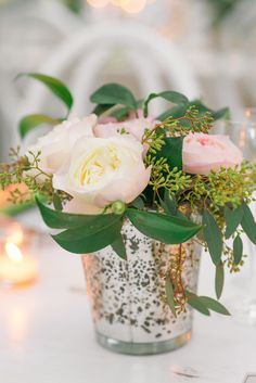 Pink roses and eucalypts mini centerpiece with a mercury vase  | Tuscan-style Southern wedding with whimsical and rustic wedding: http://www.xaazablog.com/pastel-tuscan-style-wedding-at-legare-waring-house/ | Photography: Priscilla Thomas Photography  #pinkwedding #bridalbouquet #pinkbouquet #southernwedding #tuscanwedding