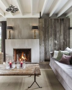 Fireplace painted with Pure & Original Lime Paint, color Old Linen. Built in media cabinet made from Canadian reclaimed barn board. TModern, & Rustic living room by designer Marie Masureel Fireplace Wall, Fireplace Design, Limestone Fireplace, Interior Decorating, Interior Design, Herd, Weathered Wood, Great Rooms, Home And Living