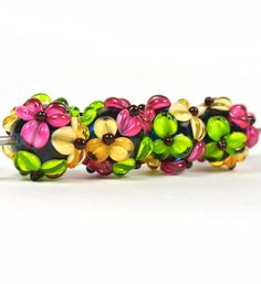 Handmade Lampwork Flower Bead Set  4 beads by catlampwork on Etsy