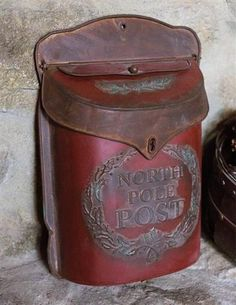 North Pole Post Box A spirited stash for holiday cards seeks a nail on a believer's wall. The metal postal box is embossed with a charming motif. 11 x Embossed tin. Tabletop Christmas Tree, Merry Christmas Sign, Prim Christmas, Christmas In July, Winter Christmas, Galvanized Decor, Victorian Trading Company, Nativity Ornaments, Stash Jars
