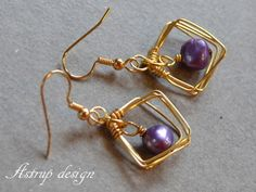 Squares of gold-plated wire with a nice purple /lavender pearl.    Here is a earring you don't see anywhere.