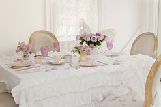 Vintage Setting with Shabby Chic Style Tablecloth.