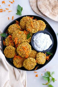 These colorful carrot falafel patties are so delicious, thanks to fresh herbs, curry, and a handful of other seasonings. Make this vegetarian dish for lunch or dinner.