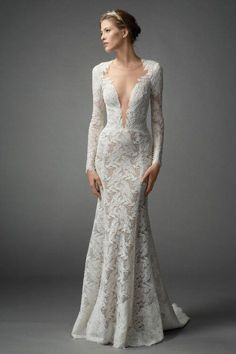 A sleek mermaid dress with a plunging neckline proves without a doubt that lace doesn't have to mean demure.