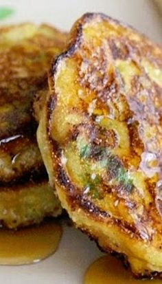 Corn Cake Fritters — These are a cross between a pancake & a fritter. Instead of deep frying as you would a classic fritter, I shallow fry them in a heavy bottomed cast iron skillet until golden on both sides. They can be served on their own or with a drizzle of honey or pure maple syrup. They embody the sweet & salty flavors that make them a scrumptious choice for any meal! #recipe #dinner
