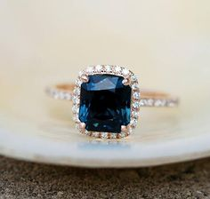 Peacock sapphire engagement ring. 2.73ct emerald cut blue