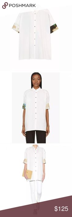 """NEW Acne Studios Wallpaper Loop Button Down Shirt Brand:  Acne Studios Material:  100% Cotton Retail: $565 Marked Size: 32 (Oversize fit - Fits Best a US Small) Approximate Measurement lying flat: Shoulder to Shoulder: 18"""" Armpit to Armpit: 23"""" Sleeve Length: 10"""" Length (Top Shoulder to Bottom hem): 26"""" Acne Tops Button Down Shirts"""