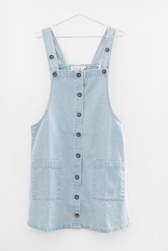 Light denim overall dress Button down front Large front patched pockets Strap length is adjustable Non-stretch light cotton denim Loose fitting 100% Cotton Impo