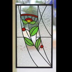 Panneau de verre, fleur stylisée