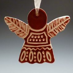 Ceramic Porcelain Dark Red Angel Christmas Ornament with Graphic Carved Sgraffito Detail