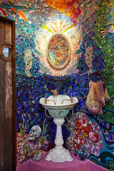 Whoa! Incredible mosaic yellow submarine tile bathroom.