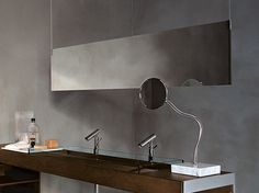 Agape, Insegna #agapedesign - Ceiling suspended, duble-sided mirrors, available in different sizes. Supported by stainless steel cables and fixing pivots + Fusilli mirror http://www.agapedesign.it/en/products/440-fusilli-spe012p. Learn more on agapedesign.it