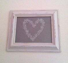 Shabby chic distressed picture frame and vintage style cross stitch